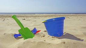 Bucket and shovel on the beach Royalty Free Stock Image