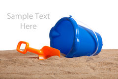 An bucket and shovel on the beach with copy space Royalty Free Stock Images