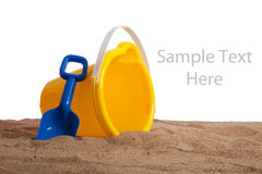 An bucket and shovel on the beach with copy space Royalty Free Stock Photo