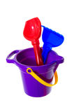 Bucket with shovel and rakes Stock Image
