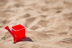 Bucket and shovel on the sandy beach Stock Photography