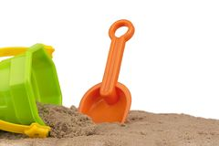Bucket and shovel toys at the beach, isolated on white background. Copy space for your text or your image royalty free stock photo