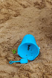 Bucket, shovel, toys in sandbox. Blue child plastic bucket with shovel in a sandbox, loneliness, childhood concept Royalty Free Stock Photography