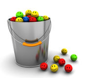 Bucket with smileys Stock Images