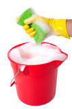 Bucket of Soap. A sudsy bucket or pale of soap with a hand holding a sponge. cleaning concept or chores Stock Images