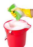 Bucket of Soap. A sudsy bucket or pale of soap with a hand holding a sponge. cleaning concept or chores Stock Photo