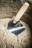 A bucket with a solution and a trowel Stock Image