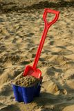 Bucket and Spade 3. Toy bucket and spade on a beach Stock Images