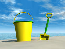 Bucket and spade on the beach Stock Photography