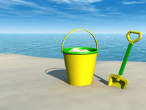 Bucket and spade on the beach Royalty Free Stock Photography