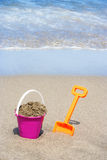 Bucket and spade for the beach Royalty Free Stock Image
