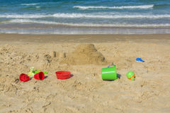 Bucket and spade on beach Stock Photo