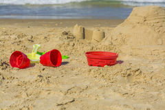 Bucket and spade on beach Stock Photography