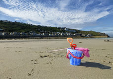 Bucket and spade on a beach Stock Photography