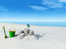 Bucket, spade and sand castle on a beach. Royalty Free Stock Image