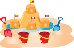 Bucket and spade and sandcastle Royalty Free Stock Images
