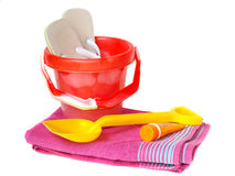 Bucket,spade,towel sun-cream and flip-flops Royalty Free Stock Photo