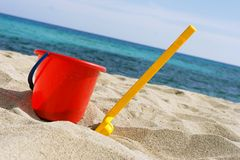 Bucket and spades. Toy on the beach Royalty Free Stock Photos
