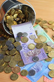 Bucket of spilled Malaysian Ringgit bank notes and coins Royalty Free Stock Photo