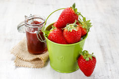 Bucket of strawberries on wooden table Stock Photography