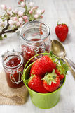 Bucket of strawberries on wooden table Royalty Free Stock Photography