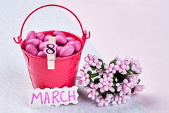 Bucket with sweets and flowers. Stock Images