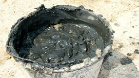 Bucket with therapeutic mud at Techirghiol. Picture taken at Techirghiol lake Stock Photos