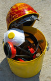 Bucket with tools and construction safety equipment. Royalty Free Stock Photos