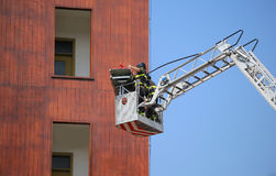 Bucket truck with firefighters during exercise in the firehouse Stock Photography