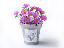 Bucket With Violet Flowers Royalty Free Stock Photo