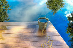 Bucket  water on  jetty   mouth  Volga river Stock Photos