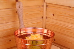 Bucket with water in sauna Stock Image