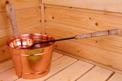 Bucket with water in sauna Stock Photo