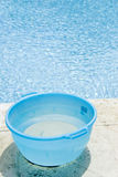 Bucket of Water by a Swimming Pool royalty free stock photography