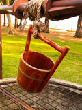 Bucket of water on well. Iin agriculture village and  park, craft wooden , vintage and antique of Thailand Royalty Free Stock Photo