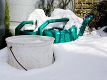 Watering cans in snow Stock Photography