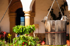 Bucket from a Well. A bucket from a well in a monastery courtyard Stock Photo