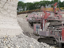 Bucket-wheel excavator in a chalk open pit mine. royalty free stock images