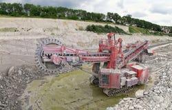 Bucket-wheel excavator in a chalk open pit mine Stock Image