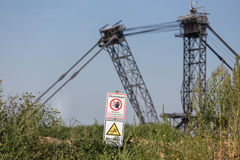 Bucket wheel excavator with german warning sign Stock Photos