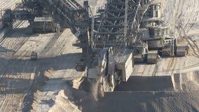 Bucket-wheel excavator mining. Bucket-wheel excavator mining in a brown coal open pit mine stock footage