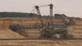Bucket-wheel excavator mining. Bucket-wheel excavator mining in a brown coal open pit mine stock video footage