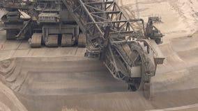 Bucket-wheel excavator mining. Bucket-wheel excavator mining in a brown coal open pit mine stock video