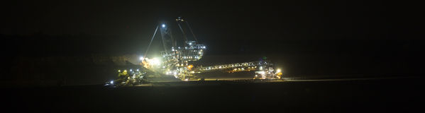 Bucket-wheel excavator at night in open-cast coal mining hambach Royalty Free Stock Photos