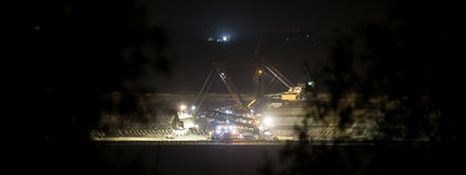 Bucket-wheel excavator at night in open-cast coal mining hambach Stock Images