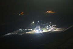 Bucket-wheel excavator at night in open-cast coal mining hambach Stock Image