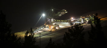 Bucket-wheel excavator at night in open-cast coal mining hambach Royalty Free Stock Photography