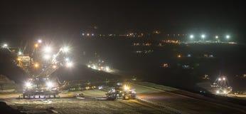 Bucket-wheel excavators at night in open-cast coal mining hambac Royalty Free Stock Photo
