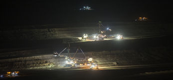 Bucket-wheel excavators at night in open-cast coal mining hambac Royalty Free Stock Photo