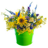 Bucket with wildflowers. On pure white Royalty Free Stock Photo